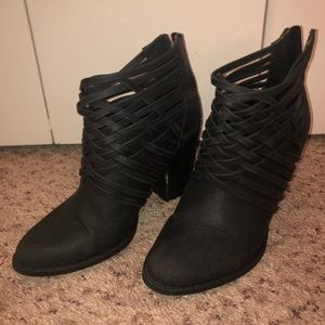 Black heeled booties with crossover detail